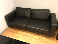 Faux leather 3 seater settee, armchair and a coffee table