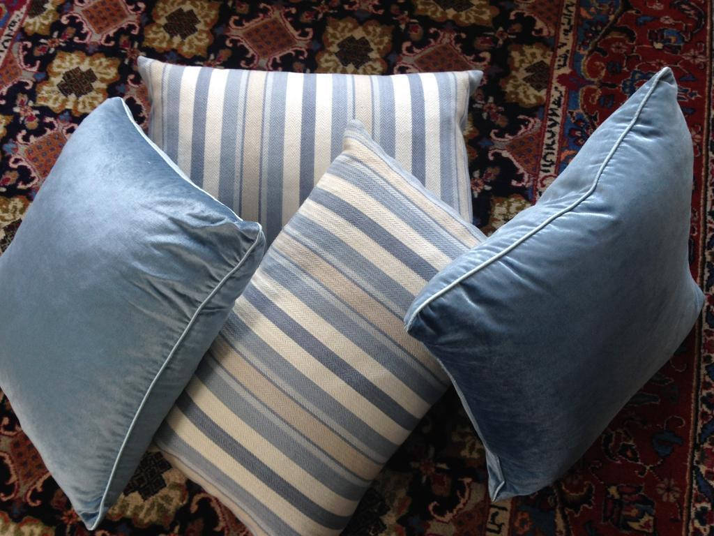 Four LAURA ASHLEY filled cushions - 2 velvet/satin blue and 2 contrasting textured stripe Cost +£150