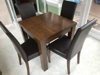 Extending dining table with 4 cushioned chairs, good condition