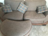 Sofa two seater with blue chequered cushions and footstool