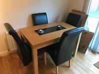 Solid Oak table with 4 black chairs