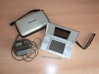 Silver Nintendo DS Lite with case, charger, stylus and three games.