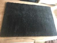 Large black high pile rug