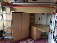 High Sleeper Bed with Mattress. Desk, wardrobe, shelves all built in. Good condition.