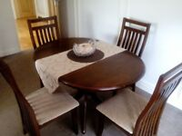 dinning table and four chairs.
