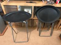 Three black folding tables