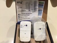 BT Wi-Fi Home hotspot plus 600 power line adaptor. Unused, in original box, full instructions.