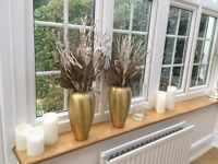 2 golden vases with dried flower display