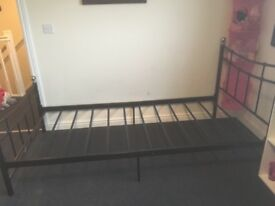 Black metal single bed