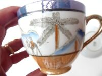 Antique cup. Japanese eggshell porcelain. Lustre ware. Vintage china cup and saucer.