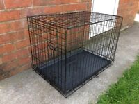 DOG CRATE/ CAGE, 30 INCHES LONG, 19 INCHES WIDE AND 21 INCHES TALL