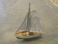 Model sailing ship yacht boat on wooden stand - blue and white striped sails