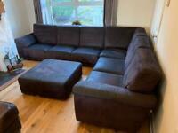 Corner sofa charcoal black and matching footstool