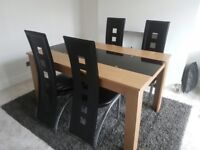 Black glass and oak dining table with 4 chairs
