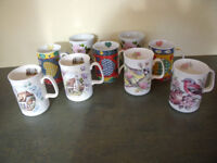 MUGS: 9 fine bone china of various designs- hearts, roses, birds, cottages. £1.50 each/£12 ovno lot