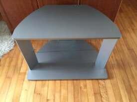 TV unit with glass shelf
