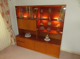 Tall Wall Unit/ Display Unit, in teak, by Morris of Glasgow, with matching TV/Video unit.