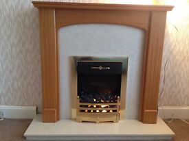 Marble and polished wood fire place and built in heater