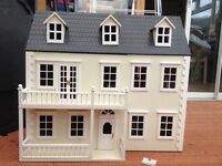 Classic wooden dolls house in great condition