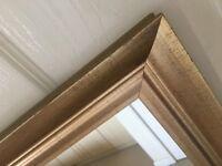 Full length, gold effect framed mirror