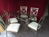 GLASS / METAL DINING TABLE WITH 6 CHAIRS ,CAN DELIVER