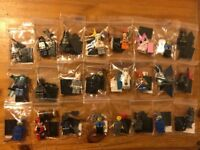 Lego Movie and Batman Minifigures with weapons and base stands