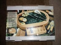 Cheese board set with utensils