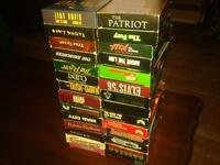60  vhs  movies  these are all s good action movies some western