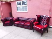 A oxblood red leather chesterfield suite