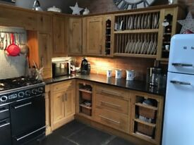 Rustic oak kitchen and falcon cooker, 5 ring gas bob, double oven, sink and tap, integrated washer.