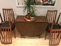 Wooden fold away oval table with 4 chairs