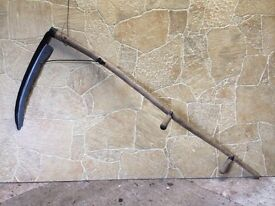 Vintage long handled sythe in good condition