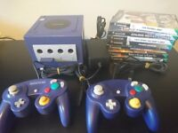 Nintendo Gamecube with 2 controllers, memory card and 8 games