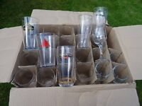 18 collectors pint glasses and 4 wine glasses