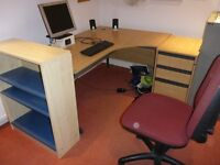 Office desk, cabinet, shelves, chair, screen, keyboard