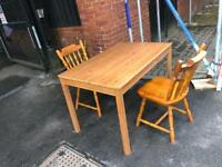 Pine dinner table and 2 chairs £40
