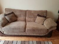 Lovely soft brown corderoy sofa with fake leather trim really comfy only year old 150