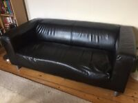 Black two-seat sofa. Second-hand. FCO.