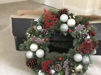 Christmas trees and beautiful wreath and pine cone strings and halloween decorations