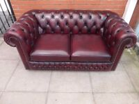 A Deep Oxblood Red Leather Chesterfield Two Seater Sofa