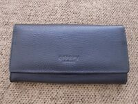 OSPREY leather purse/wallet. Brand new. Not used. Black. Clasp missing.