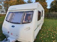 4 berth caravan Lunar Zenith with full awning and caravan cover.