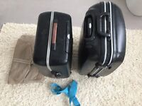 Two hard shell black suitcases 1x Samsonite 1x Delsey
