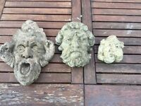 Three stone faces/garden wall plaques