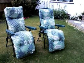 Two reclying garden chairs