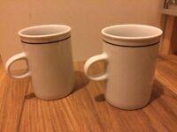 A pair of americano mugs