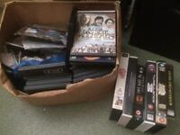 big bag of dvds top titles and VHS videos prerecorded and blanks