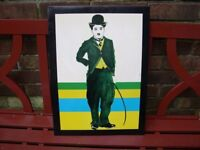 A colourful tinprint of Charlie Chaplin.