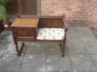 Antique vintage telephone seat and table .