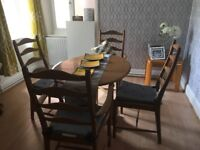 Four ercol dining chairs